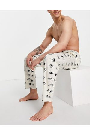 ASOS DESIGN Lounge trousers with eyes print-Multi