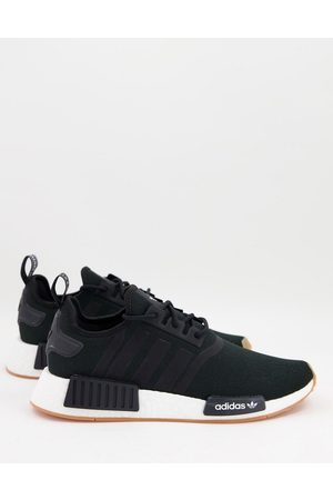 adidas Originals NMD_R1 Primeblue trainers in with gum sole