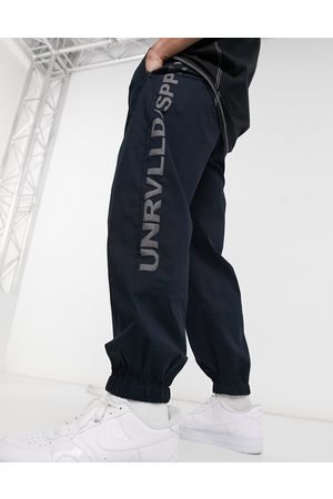 ASOS Unrvlld Spply Oversized tapered joggers in -Navy