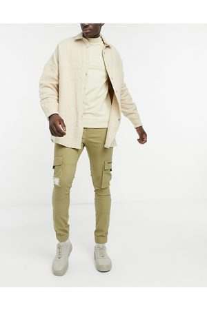 ASOS Unrvlld Spply Tapered cargo trousers in stone-Neutral