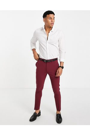 ASOS DESIGN Super skinny suit trousers in burgundy