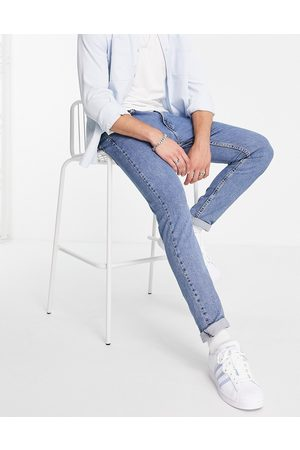 Levis Levi's 512 slim tapered fit lo-ball jeans in mid wash