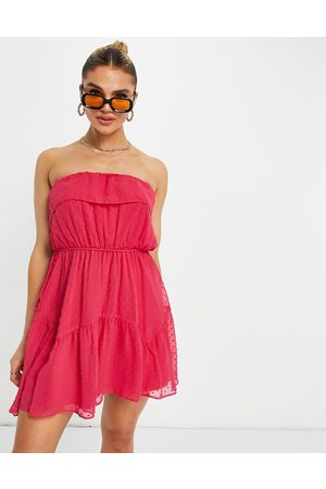 ASOS DESIGN Ruffle bandeau mini skater dress with belt in dobby in hot