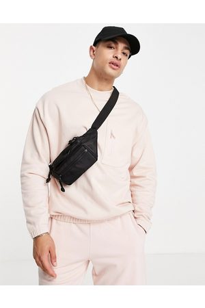 ASOS DESIGN Co-ord oversized sweatshirt with pocket detail in