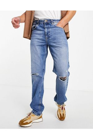ASOS DESIGN Straight leg jeans in vintage mid wash with knee rips