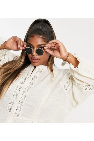 Only Curve Blouse with lace inserts and volume sleeves in cream