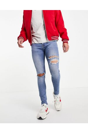 ASOS DESIGN Spray on jeans with powerstretch in mid with knee rips