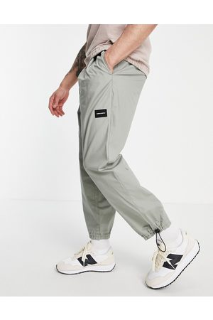 ASOS DESIGN ASOS Unrvlld Spply lightweight oversized tapered joggers in