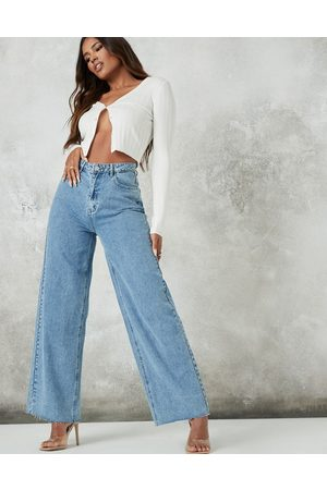 Missguided Wide leg jean with raw hem in