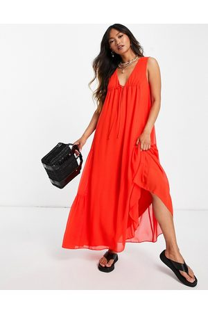 ASOS DESIGN Sleeveless trapeze maxi dress with tie detail and side tiers