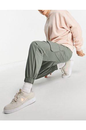 ASOS Men Cargo Pants - Oversized tapered cargo trousers in khaki