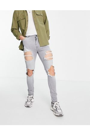 ASOS Spray on jeans with power stretch in with heavy rips