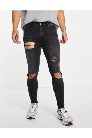 ASOS Men Jeans - Spray on jeans with powerstretch in washed wash with heavy rip
