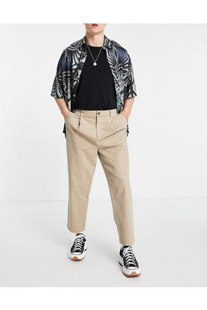 ASOS Wide fit chinos with pleats in -Neutral