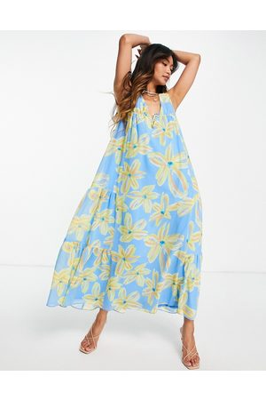 ASOS Sleeveless trapeze maxi dress with tie detail side tiers in 70s brushwork floral print-Multi