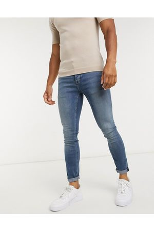 Topman Organic cotton blend spray on jeans in mid wash