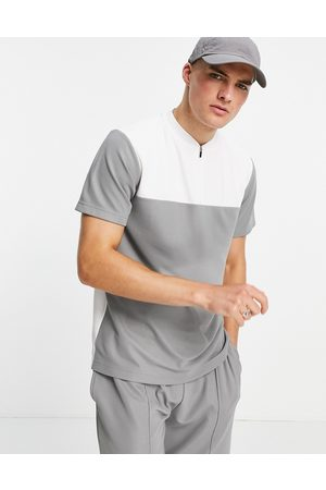Topman Classic fit polo with baseball neck in cut and sew charcoal