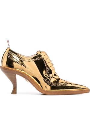 Thom Browne Metallic longwing brogues with sculpted heel