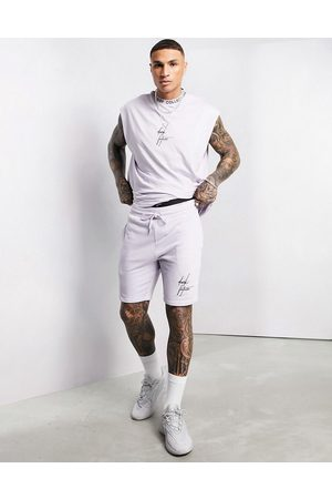 ASOS Relaxed shorts in misty lilac with logo trim