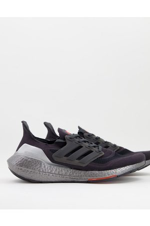 adidas performance Adidas Training Ultraboost 21 trainers in red and