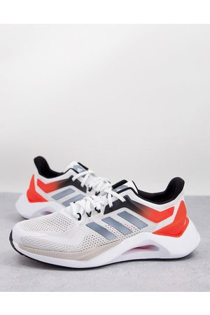 adidas performance Adidas Training Alphatorsion 2.0 trainers in red and