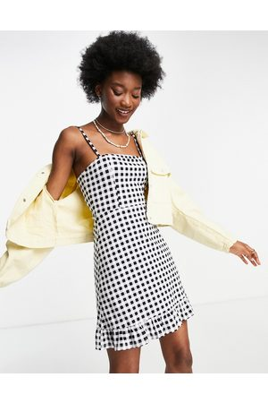 ASOS Strappy sundress with pep hem in and white gingham