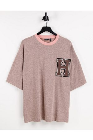 ASOS Oversized t-shirt in heavyweight marl with chest badge
