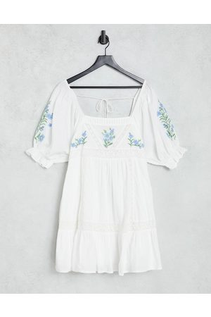 ASOS DESIGN Lace insert mini smock dress with floral embroidery in