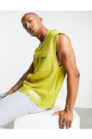 ASOS Unrvlld Spply Vest in waffle with utility pockets & logo tab