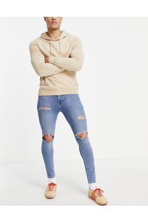 ASOS Spray on jeans with power stretch in vintage mid wash with rips