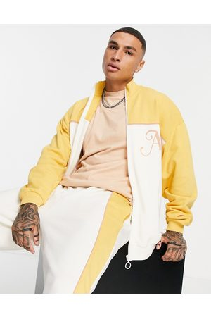 ASOS Oversized jersey jacket in neutral colour block with piping details & embroidery