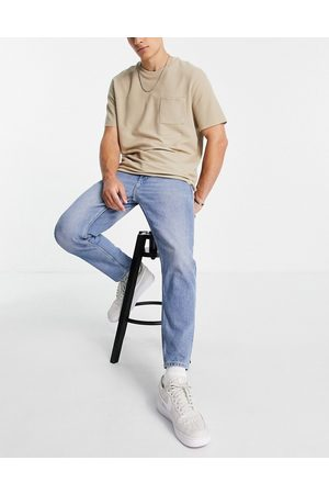 ASOS Organic cotton blend classic rigid jeans in vintage mid wash