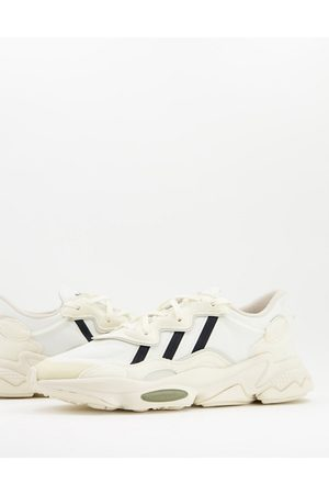 adidas Ozweego trainers in cream and black