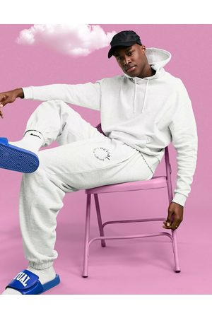 ASOS Athleisure oversized jogger in marl with health and wellbeing print