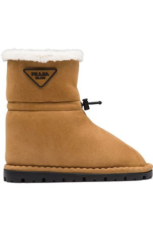 Prada Shearling-lined logo plaque ankle boots