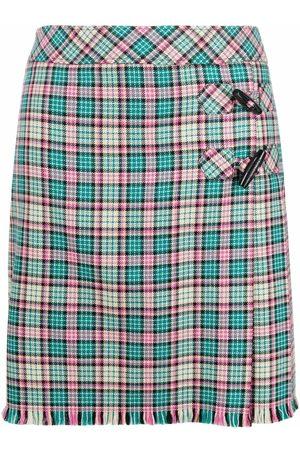 Moschino Women Pleated Skirts - Checked wool wrap skirt