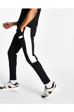 HUGO BOSS Men Joggers - Hadiko Batch logo joggers with contrast side panel in