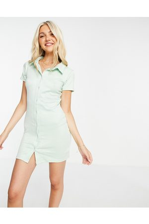 In The Style X Olivia Bowen button frill ribbed mini dress in sage