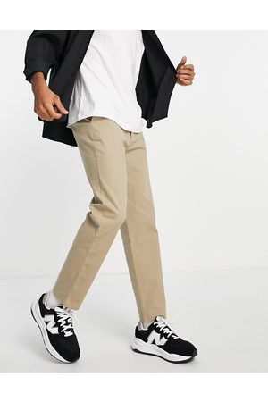 ASOS Relaxed skater chinos in -Neutral