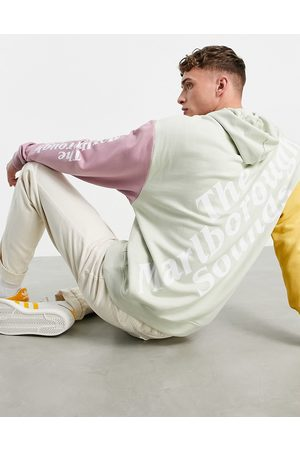 ASOS Men Sweatshirts - Oversized hoodie in colour block with multi placement print