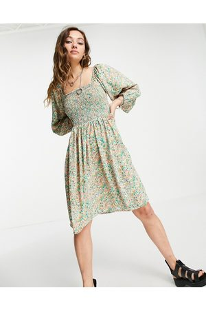 ONLY Women Casual Dresses - Mini smock dress with shirring and volume sleeves in floral print