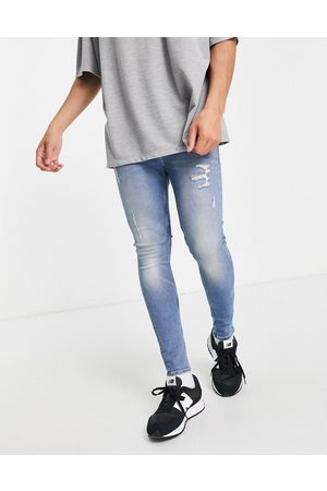 ASOS Men Skinny - Organic cotton blend spray on jeans with powerstretch in vintage light wash with abrasions