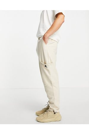 ASOS Men Sets - Organic co-ord oversized joggers with toggle pockets in -Neutral