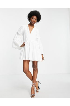 In The Style X Lorna Luxe volume sleeve smock dress in
