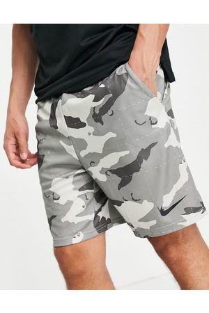 Nike Camo all over print shorts in