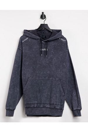 ASOS Oversized hoodie in acid wash with Paris city prints