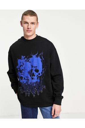 ASOS Oversized sweatshirt in with gothic skull print and metal stud details