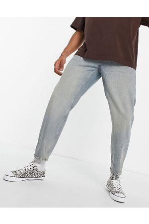 Topman Relaxed jeans in light wash with tint