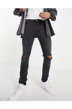 Religion Slim tapered leg jeans in with rips