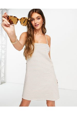 ASOS Mini sundress with cut out detail in towelling in cream stripe